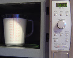 Heat milk in microwave